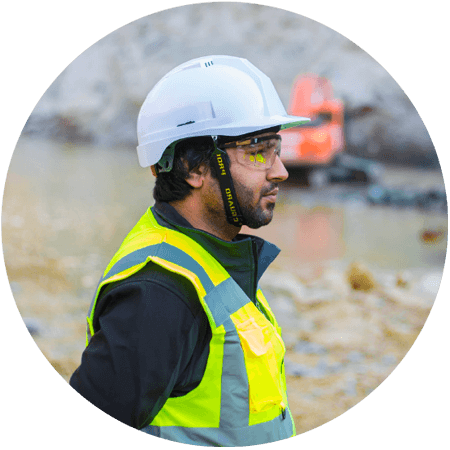 Side profile of man wearing Hi-Vis personal protective equipment