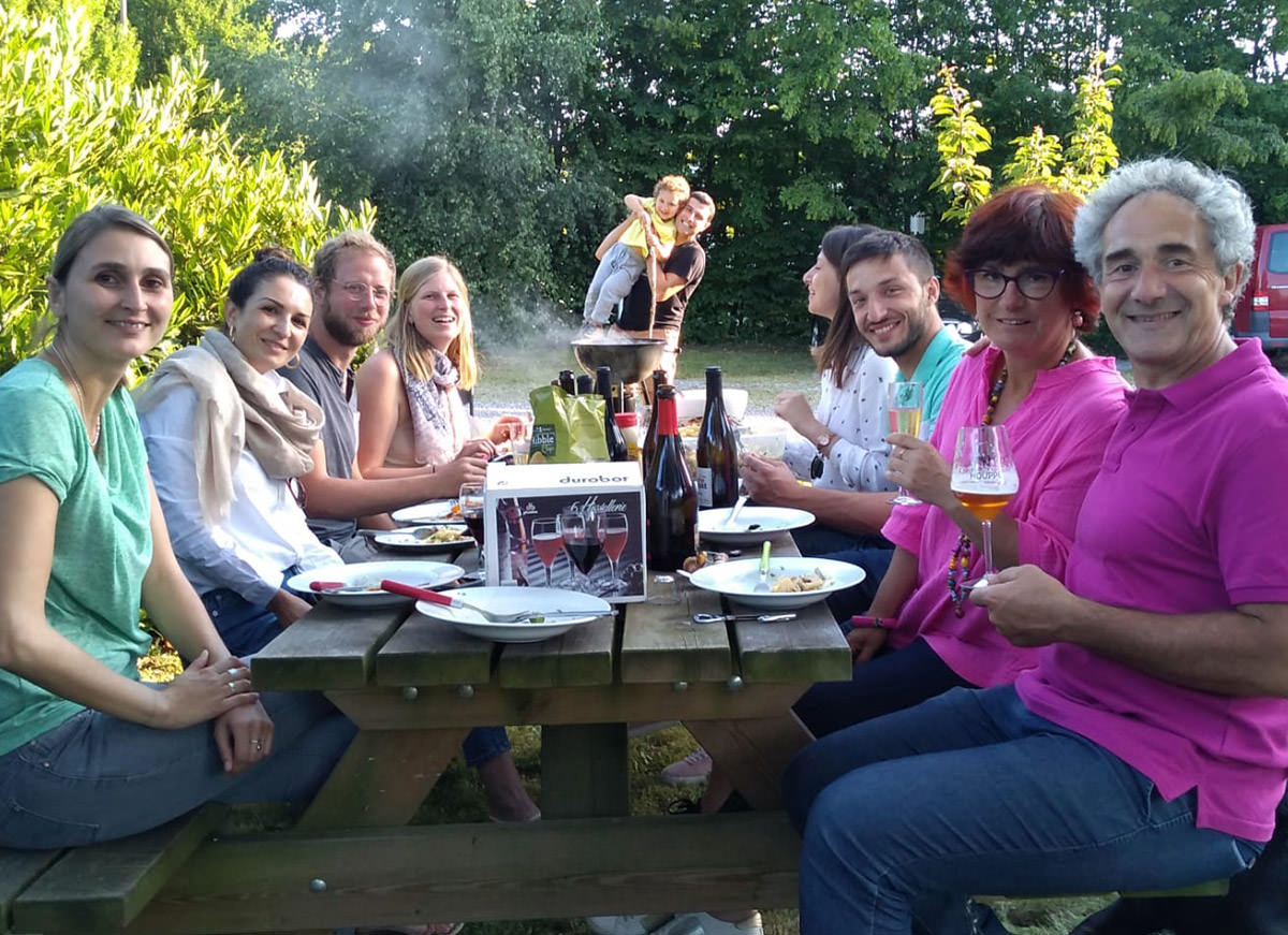 Some of the AQUALE team sitting at picnic table enjoying a barbeque