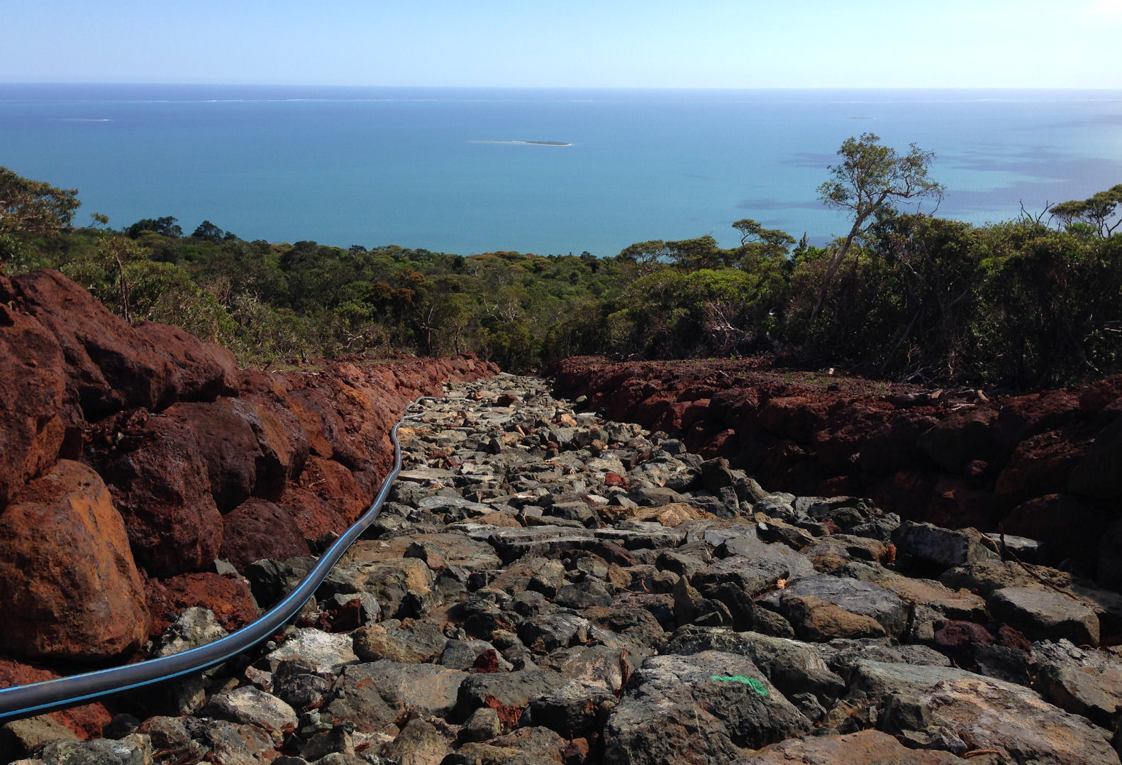 Open pit quarry water runoff system in New Caledonia