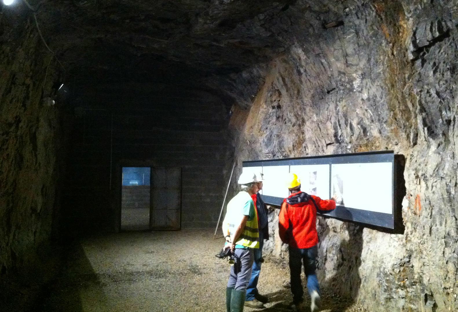 Three men performing underground quarry inspection