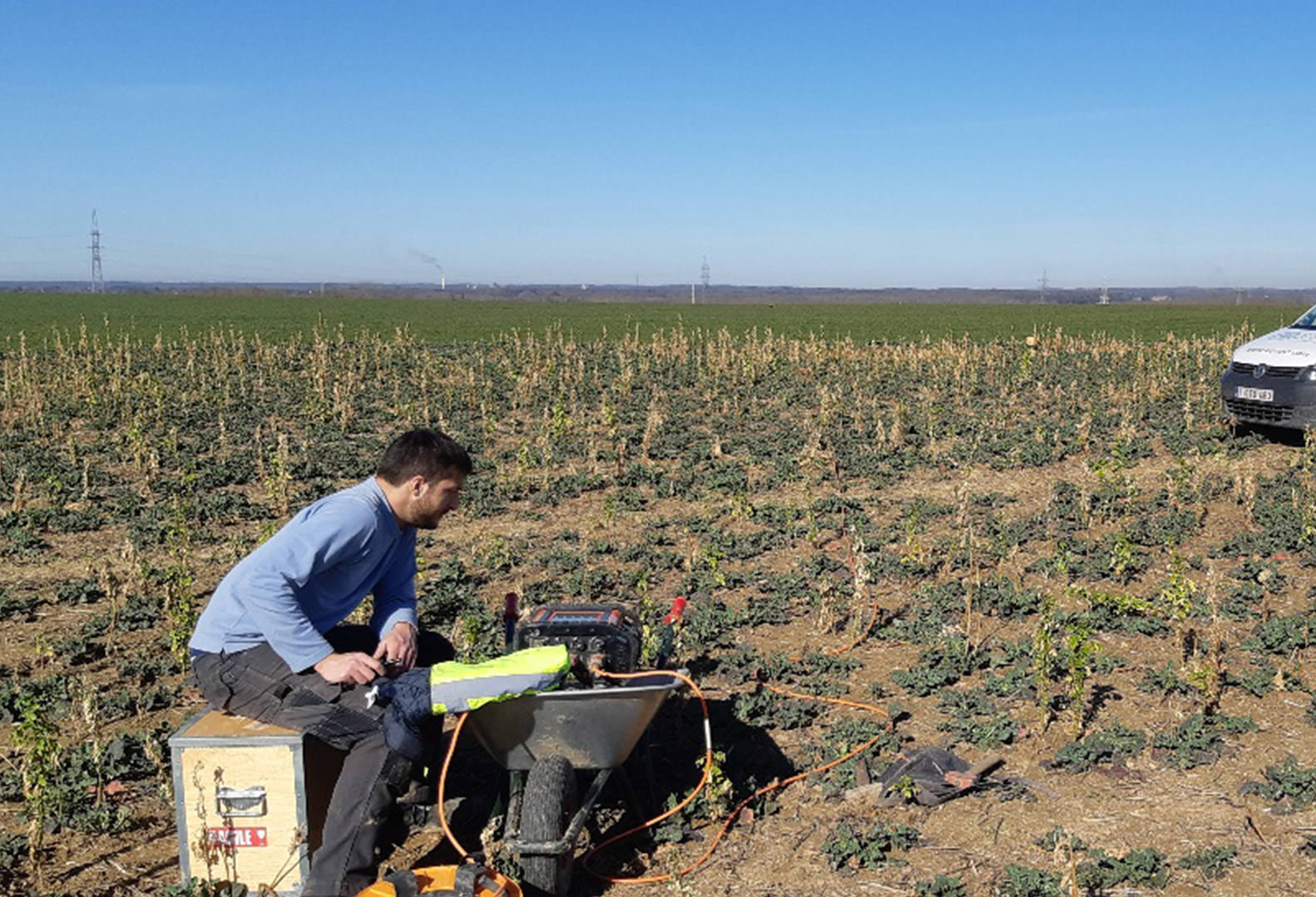Man performs Geophysical Data Acquisition in Belgium field
