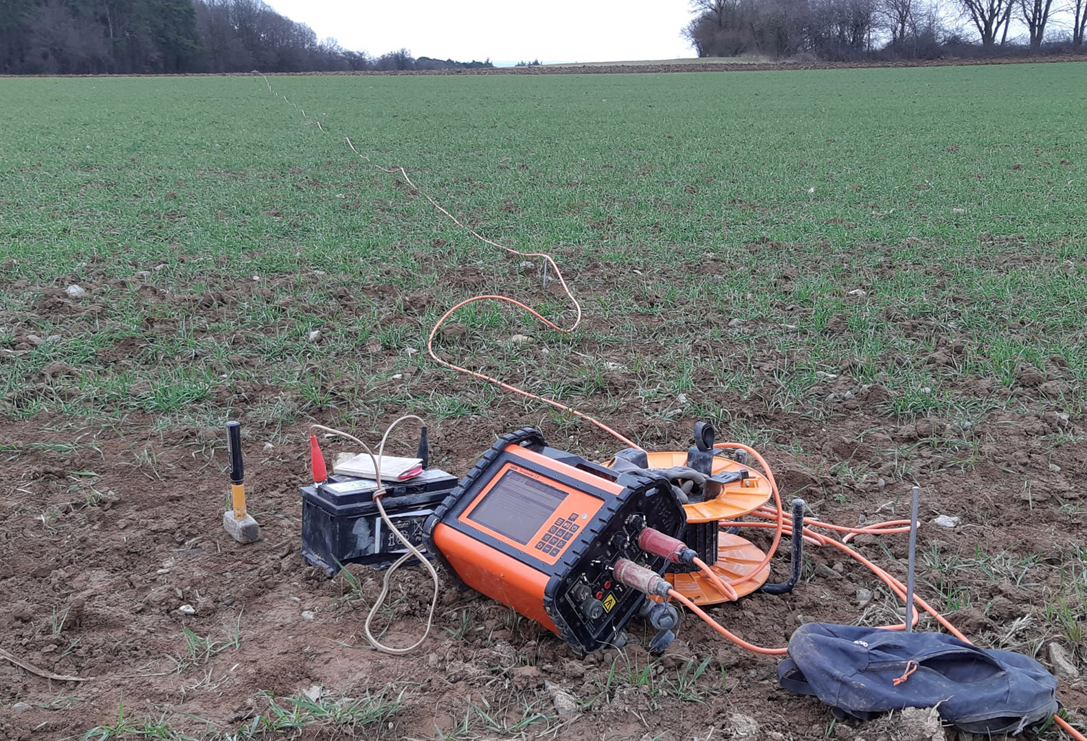 Instrument used for geophysical acquisition pictured on grass patch