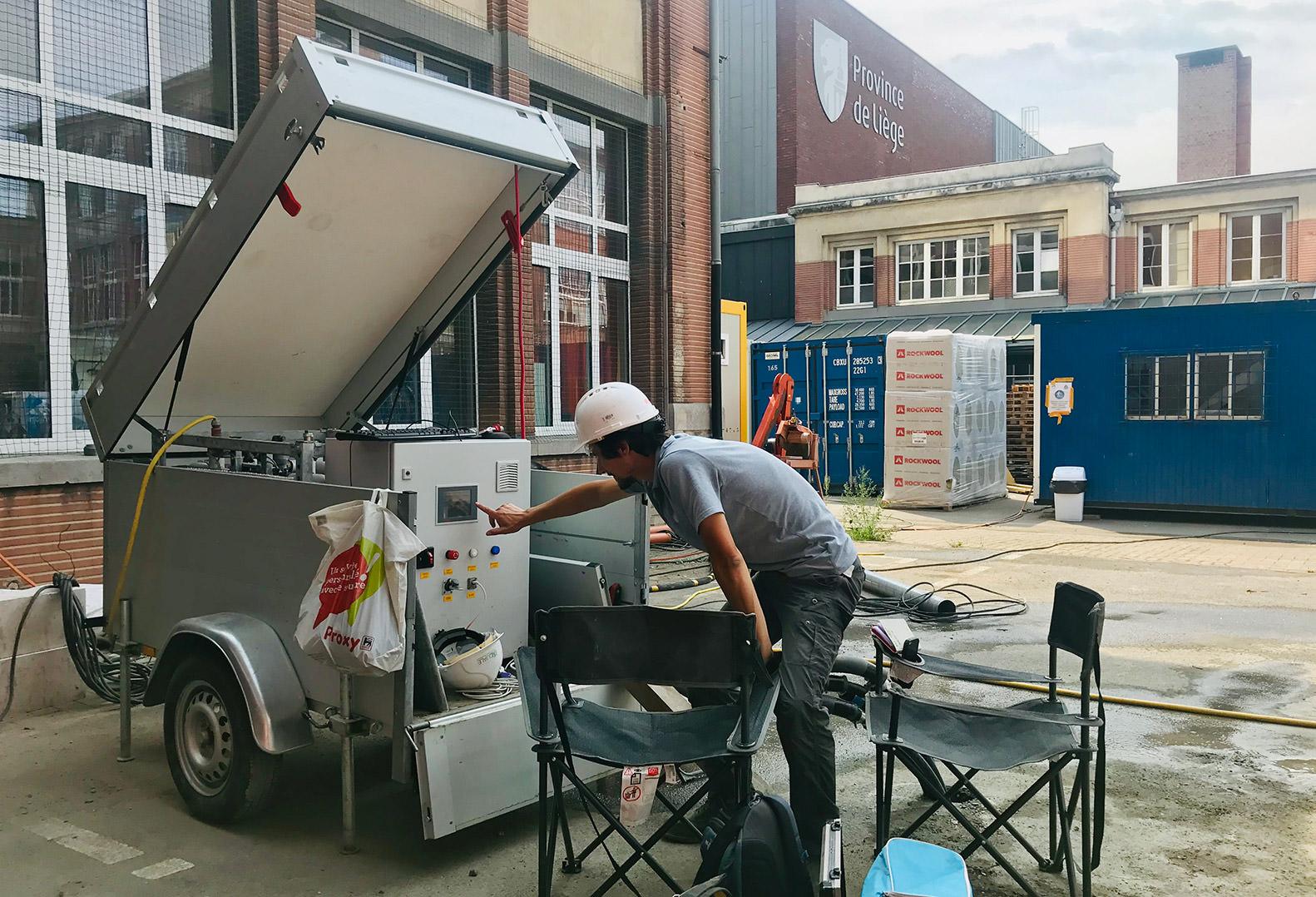 Man wearing hard hat performs Thermal Response Test